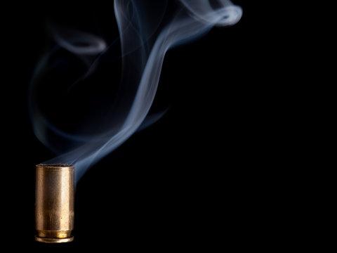 Smoking bullet casing