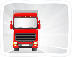 big red truck on the road with abstract background in frame