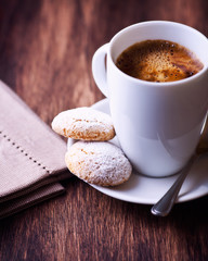 Cup of coffee and two biscotti