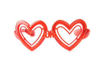 red glasses with heart shape glass