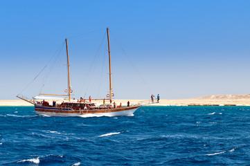 Sailboat on the coastline background