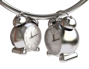 Time Concept With Metallic Alarm-Clocks
