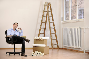 Architect or owner in empty office room