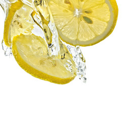 Foto op Canvas Opspattend water Lemon slices in water splash, white background, isolated