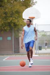 Basketball player dribbling the ball