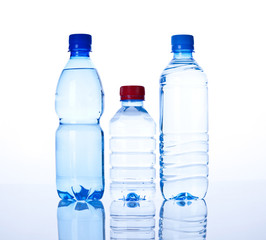 three Bottles water over a white background