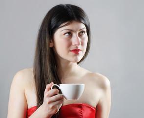 Beatiful young  woman drinking coffee