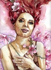 Piękna kobieta w otoczeniu różowych kwiatów jabłoni.