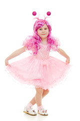 A girl with pink hair in a pink dress dancing