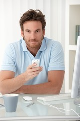 Portrait of man with cellphone handheld