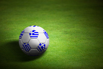 Flag of Greece with soccer ball over grass - Euro 2012