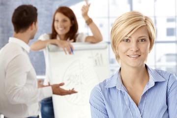 Happy businesswoman in meeting room
