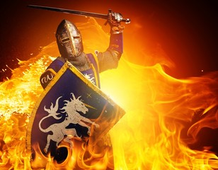 Foto op Canvas Ridders Medieval knight in attack position on fire background.
