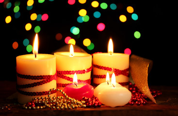 Beautiful candles and decor on wooden table on bright background