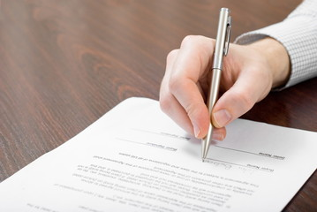 Signing contract by businessman