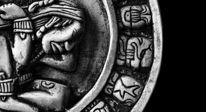 carved glyphs on a stone Mayan calendar