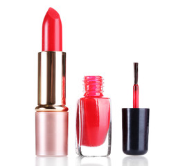 red lipstick and nail polish isolated on white