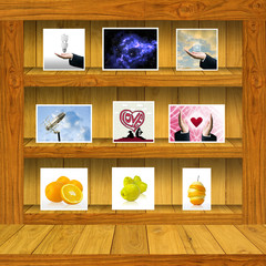 Wood shelf with stock photo inside