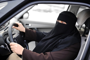 Arabic Muslim woman driving a car