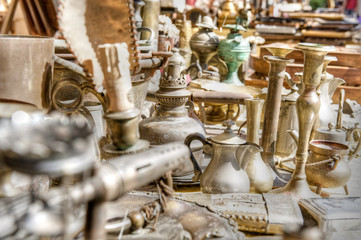 Brass antiques at a market stall. High dynamic range image.