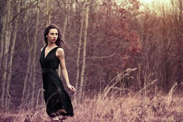 beautiful brunette posing in a field