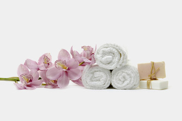 SPA beauty treatment -flower and towels and handmade soap