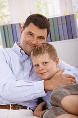 Father and son hugging smiling