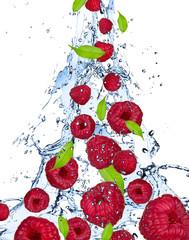 Raspberries in water splash, isolated on white background
