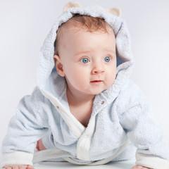 portrait of a cheerful child in blue bathrobe