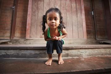 Cute little Asian girl looking at camera Fototapete