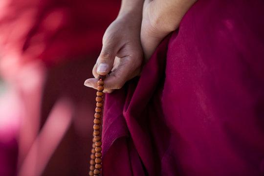 Prayer beads in monk's hand