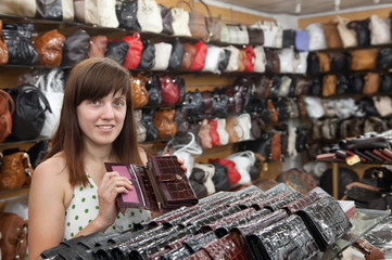 woman chooses leather wallet