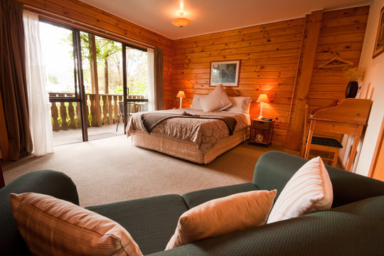 Interior of mountain wooden lodge bedroom
