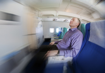 Businessman resting on a airplane
