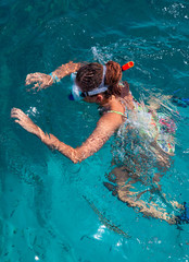 A woman wearing a mask for diving