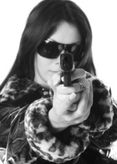young woman with a gun isolated