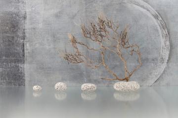 Stilleben mit Zweig und Steinen