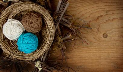 Balls of yarn in a nest