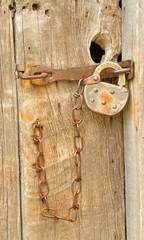 Old Lock on Weathered Wooden Door