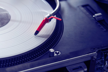 Professional turntable playing vinyl record