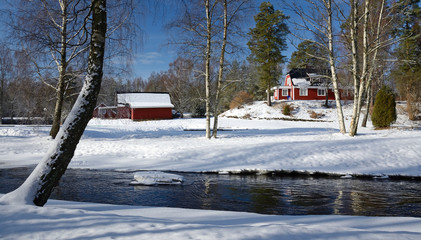 Winter landscape with Swedish cottage