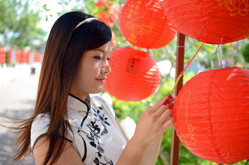 young chinese woman holding red paper lantern