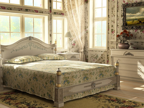 Antique luxury bedroom with large windows lighting the room. Flo