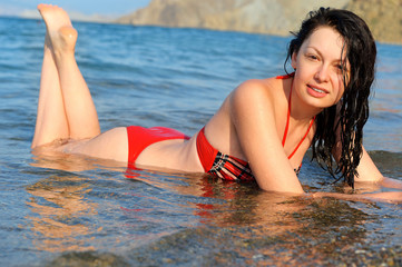 The woman lies on seacoast
