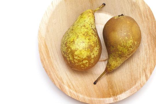pears on palm leaf plate