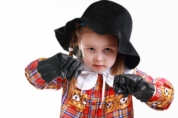 A little girl in the hat and gloves boxing