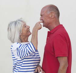mature woman picking on her husband's teeth