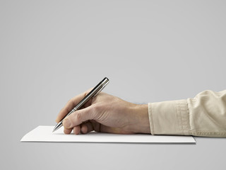 Pen in hand Isolated on grey background (clipping path)