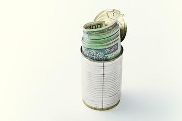 Banknoty schowane w puszce