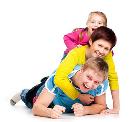 young family is on a white floor